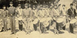 """Drum Corps of 8th Maine Vol. Infantry, Taken at Richmond, August 1865"" [McArthur Family Papers]. - Albumen photoprint showing a single black drummer boy in the last row of those assembled."